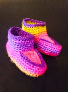 Variety of cotton, wool, and acrylic blend Infant slippers by Karin Groth $20/ea