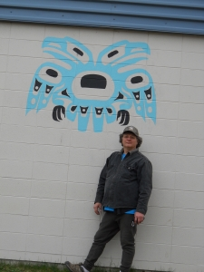 joe beside eagles on building