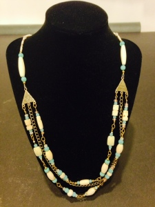 This handmade necklace is a wearable art piece that is made of: Bone Hairpipe and Carved Bone Beads, Amazonite, Glass, Copper and Antique Brass Beads by Joan Turecki