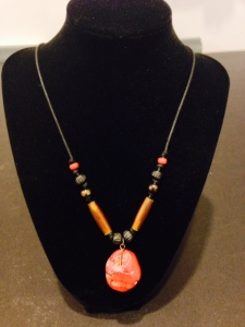 This handmade necklace is inspired by the colors of Northwest Coast First Nations art and is made from: Coral, Carved Bone, Horn, and Glass Beads by Joan Turecki